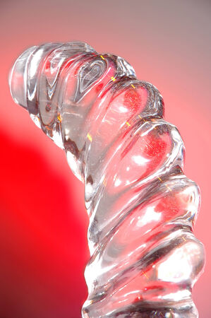 A close up of an ice sculpture on red background.