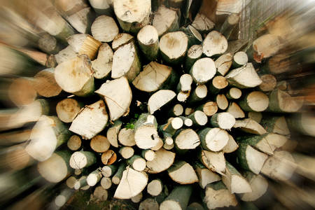 zooming: Digitally altered zooming of a woodpile chopped for heating. Stock Photo