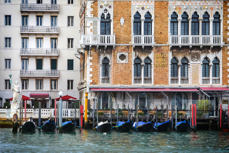 lined up: VENICE, ITALY -  FEBRUARY 15 : A view of empty gondolas moored and lined up at a gondola dock in a grand canal in front of Hotel Bauer Palazzo on February 15, 2014 in Venice, Italy.