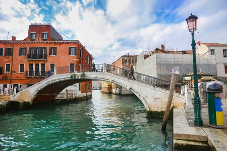 VENICE, ITALY - FEBRUARY 15 :A view of a water canal with people walking over the bridge on the square San Pantalon on February 15th, 2014 in Venice, Italy.