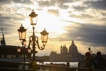 A view of the Santa Maria della Salute church from across the grand canal at sunset on in Venice, Italy. Stock Photo