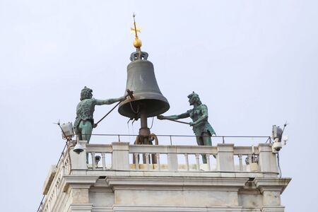 The bell and statues on the top of the Saint Mark Clocktower on the Piazza San Marco in Venice, Italy. photo