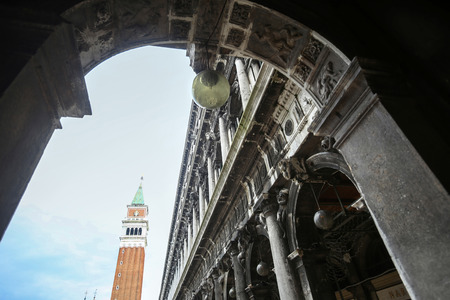 nuove: A wide angle view of the San Marco campanile from below the arch of  Procuratie building on Piazza San Marco in Venice, Italy. Stock Photo