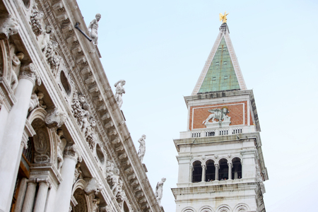 piazza san marco: A low angle view of the top of the San Marco campanile and the Marciana National Library on the Piazza San Marco in Venice, Italy. Stock Photo