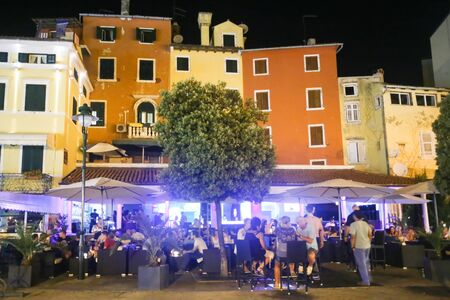 6 people: ROVINJ CROATIA  AUGUST 6 : People sitting on terrace of a night club on the promenade on August 6th 2013 in Rovinj Croatia. Rovinj is a tourist destination on Adriatic coast of Croatia. Editorial