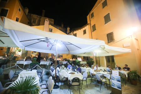6 people: ROVINJ CROATIA  AUGUST 6 : People sitting in a restaurant terrace at night on August 6th 2013 in Rovinj Croatia. Rovinj is a tourist destination on Adriatic coast of Croatia. Editorial