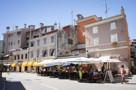 ROVINJ CROATIA  AUGUST 5 : People sitting in a restaurant on the promenade on August 5th 2011 in Rovinj Croatia. Rovinj is a touristic destination on Adriatic coast of Croatia.