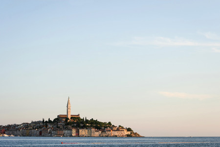 A view of the old city core with the Saint Euphemia church and bell tower in Rovinj Croatia. photo