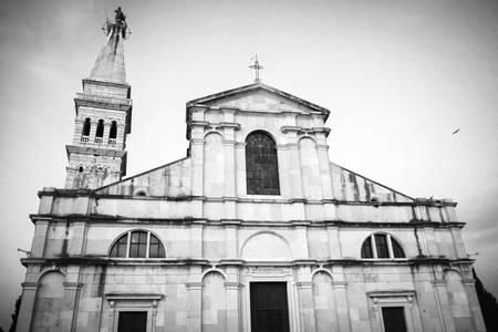 A low angle view of the Saint Euphemia church and bell tower in Rovinj Croatia. Rovinj is a touristic destination on Adriatic coast of Croatia. photo