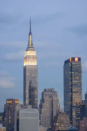 midtown manhattan: NEW YORK, USA - MARCH 9 : A digitally altered view of the Empire State Building and the Wyndham New Yorker Hotel in Midtown Manhattan on March 9th, 2005 in New York City, USA.