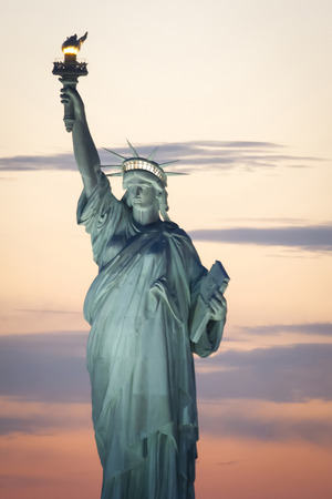liberty island: The Statue of Liberty at sunset in New York City, USA.