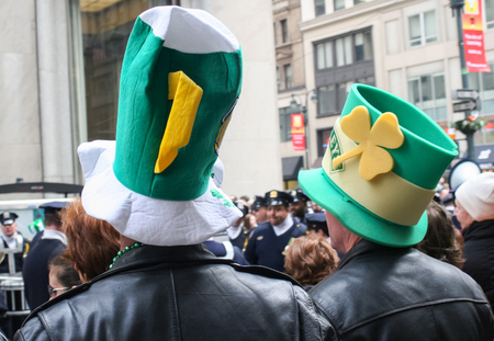 march 17th: NEW YORK CITY, USA - MARCH 17 : A rear view of two people with irish hats participating the Saint Patricks Day Parade on March 17th, 2005 in New York City, USA. Editorial