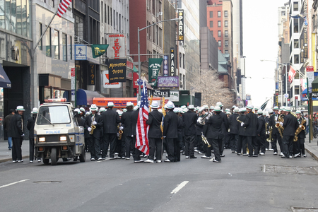 NEW YORK CITY, USA - MARCH 17 : A large group of costumed trumpeters standing in the street and waiting fot the march on the Saint Patricks Day Parade on March 17th, 2005 in New York City, USA.