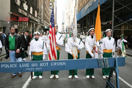 march 17th: NEW YORK CITY, USA - MARCH 17 : Costumed parade participants standing in the street in front of a police barricade on the Saint Patricks Day Parade on March 17th, 2005 in New York City, USA.