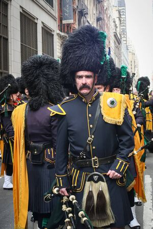 march 17th: NEW YORK CITY, USA - MARCH 17 : A front view of a man dressed in a costume participating the Saint Patricks Day Parade on March 17th, 2005 in New York City, USA.