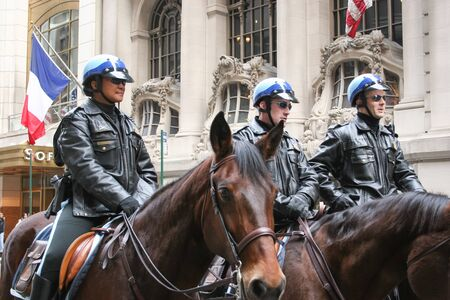 march 17th: NEW YORK CITY, USA - MARCH 17 : Three policemen riding horses in the street on Saint Patricks Day Parade on March 17th, 2005 in New York City, USA. Editorial