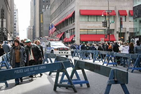 march 17th: NEW YORK CITY, USA - MARCH 17 : People in the street walking between the police barricades on the Saint Patricks Day Parade on March 17th, 2005 in New York City, USA.