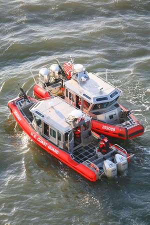 coast guard: NEW YORK CITY, USA - APRIL 30 : A high angle view of two U.S. Coast Guard powerboats sailing in the East River on April 30, 2006 in New York City, USA. Editorial