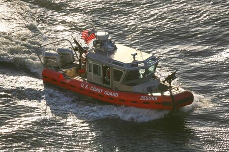 coast guard: NEW YORK CITY, USA - APRIL 30 : A high angle view of a U.S. Coast Guard powerboat sailing in the East River on April 30, 2006 in New York City, USA. Editorial