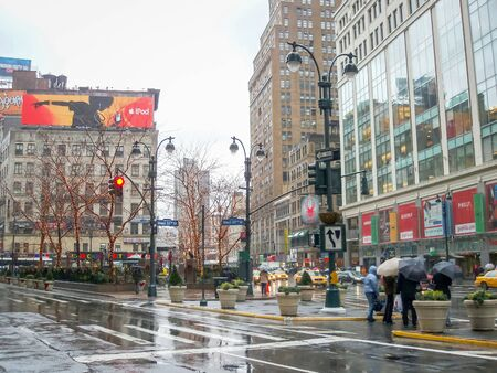 horace: NEW YORK CITY, USA - JANUARY 3 : A rainy day on Greeley Square on January 3rd, 2006 in New York City, USA. Greeley Square is located opposite to the Herald Square and is named after Horace Greeley, the founder of New York Tribune.