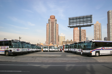 NEW YORK CITY, USA - MARCH 17 : A large group of buses parked in the city bus garage on West 38 street in Manhattan on March 17th, 2005 in New York City, USA.