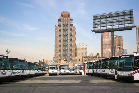march 17th: NEW YORK CITY, USA - MARCH 17 : A large group of buses parked in the city bus garage on West 38 street in Manhattan on March 17th, 2005 in New York City, USA.