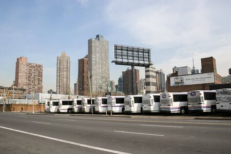 march 17th: NEW YORK CITY, USA - MARCH 17 : A large group of buses parked in the city bus garage on West 38 street and 11th Avenue in Midtown Manhattan on March 17th, 2005 in New York City, USA.
