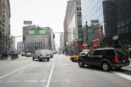 horace: NEW YORK CITY, USA - MARCH 17 : A view of traffic on Greeley Square on March 17th, 2005 in New York City, USA. Greeley Square is located opposite to the Herald Square and is named after Horace Greeley, the founder of New York Tribune.