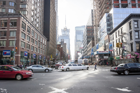 conde: NEW YORK CITY, USA - APRIL 22 : A busy intersection of 42nd West street and 9th Avenue in Midtown Manhattan with Conde Nast Building in the background on April 22th, 2005 in New York City, USA.