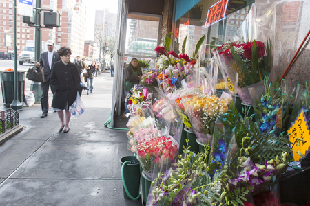 midtown manhattan: NEW YORK CITY, USA - APRIL 22 : People walking in the street next to a flower shop in Midtown Manhattan on April 22th, 2005 in New York City, USA.