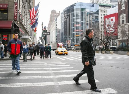 cross: NEW YORK CITY, USA - MARCH 17 : People crossing the street in Midtown Manhattan on March 17th, 2005 in New York City, USA.