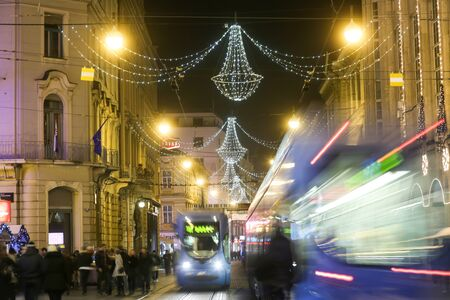 advent time: ZAGREB, CROATIA - DECEMBER 13: City trams passing by in Ilica street at Advent time on December 13th, 2015 in Zagreb, Croatia. Zagreb has been declared the best european christmas destination in 2015. Editorial