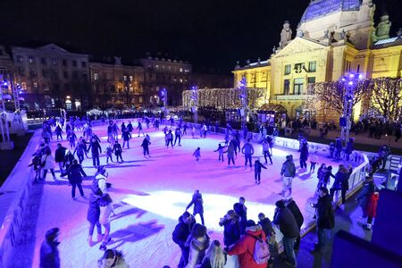 ZAGREB, CROATIA - DECEMBER 10: People skating on city skating rink in front of the Art Pavilion in King Tomislav Park on December 10th, 2015 in Zagreb, Croatia. Zagreb has been declared the best european christmas destination in 2015.