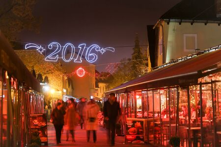 advent time: ZAGREB, CROATIA - DECEMBER 13: People walking in decorated Tkalciceva street at Advent time on December 13th, 2015 in Zagreb, Croatia. Zagreb has been declared the best european christmas destination in 2015.