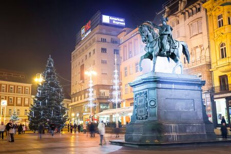 advent time: ZAGREB, CROATIA - DECEMBER 14:  Advent time at night on central Jelacic Square with the Statue of Ban Josip Jelacic on December 14th, 2015 in Zagreb, Croatia. Zagreb has been declared the best european christmas destination in 2015. Editorial