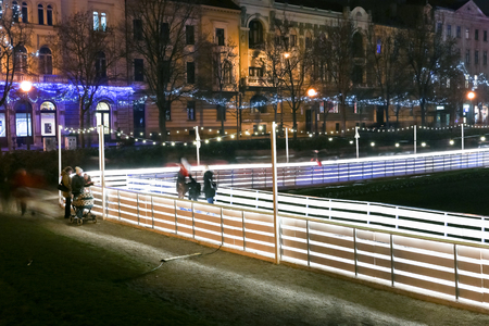 advent time: ZAGREB, CROATIA - DECEMBER 14: People skating on city skating rink at Advent time in King Tomislav Park on December 14th, 2015 in Zagreb, Croatia. Zagreb has been declared the best european christmas destination in 2015. Editorial