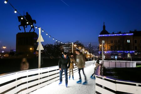 advent time: ZAGREB, CROATIA - DECEMBER 14: People skating in the city ice skating rink at Advent time in King Tomislav Park on December 14th, 2015 in Zagreb, Croatia. Zagreb has been declared the best european christmas destination in 2015.
