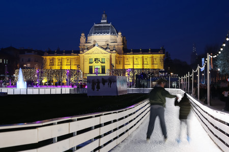 advent time: ZAGREB, CROATIA - DECEMBER 14: The city ice skating rink at Advent time in King Tomislav Park on December 14th, 2015 in Zagreb, Croatia. Zagreb has been declared the best european christmas destination in 2015.