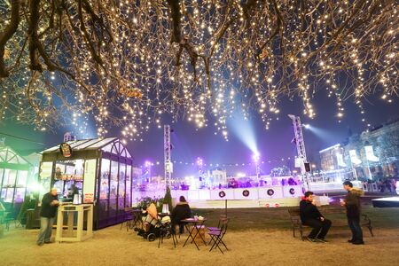 ZAGREB, CROATIA - DECEMBER 14: People in front of the ice skating rink at Advent time in King Tomislav Park on December 14th, 2015 in Zagreb, Croatia. Zagreb has been declared the best european christmas destination in 2015.