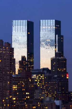 twin tower: NEW YORK CITY, USA - MARCH 25 : The Time Warner Center twin tower office building with residential skyscrapers in Midtown Manhattan at night on March 25th, 2005 in New York City, USA.