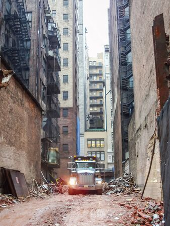 midtown manhattan: A front view of a truck on a construction site among old buildings in Midtown Manhattan in New York City, USA. Stock Photo