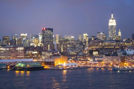 midtown manhattan: A view of the panorama of Midtown Manhattan coast at sunset in New York City, USA. Stock Photo
