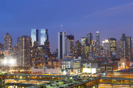 morning blue hour: NEW YORK CITY, USA - MARCH 25 : A view of a parking lot on top of a building and the panorama of Midtown Manhattan at sunset on March 25th, 2005 in New York City, USA. Editorial