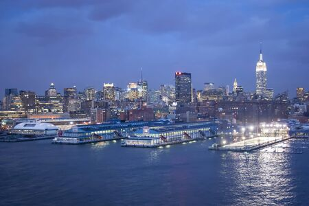 midtown manhattan: NEW YORK CITY, USA - MARCH 9 : A view of the panorama of Midtown Manhattan coast with Chelsea piers sports and entertainment complexat at sunset on March 9th, 2005 in New York City, USA.
