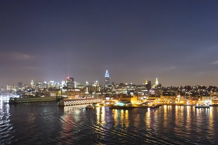 hudson river: The panorama of Midtown Manhattan coast viewed from the Hudson River at night in New York City, USA.