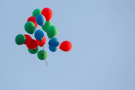 directly below: A view from below of a group of colorful balloons flying in the air. Stock Photo
