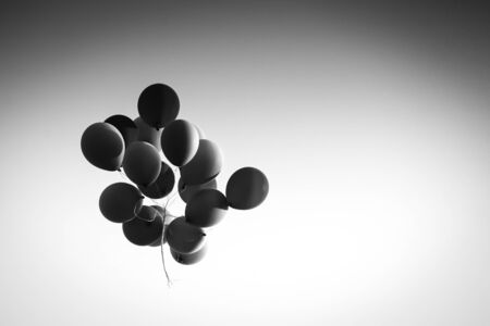 flying float: A view from below of a group of  balloons flying in the air. Stock Photo