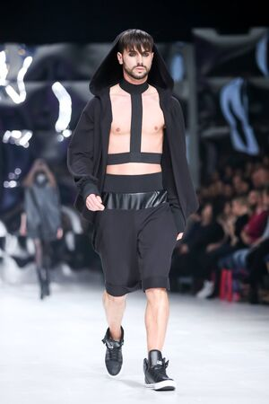 jure: ZAGREB,CROATIA-MARCH 17,2016:Model wearing clothes designed by Coded Edge on the Bipa Fashion.hr fashion show in Zagreb, Croatia. Coded Edge is Croatian fashion label,by Silvio Ivkic and Jure Perisic.