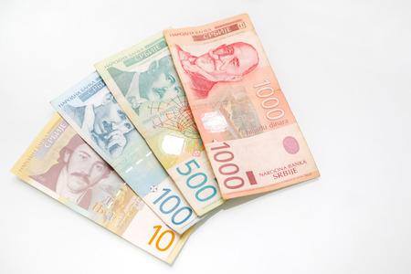 dinar: Different Serbian dinar bills arranged on white background. Stock Photo