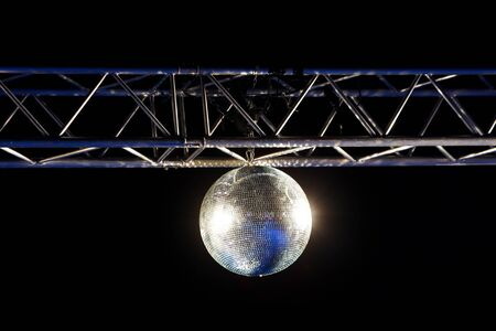 steel construction: An isolated disco ball hanging from a steel construction. Stock Photo